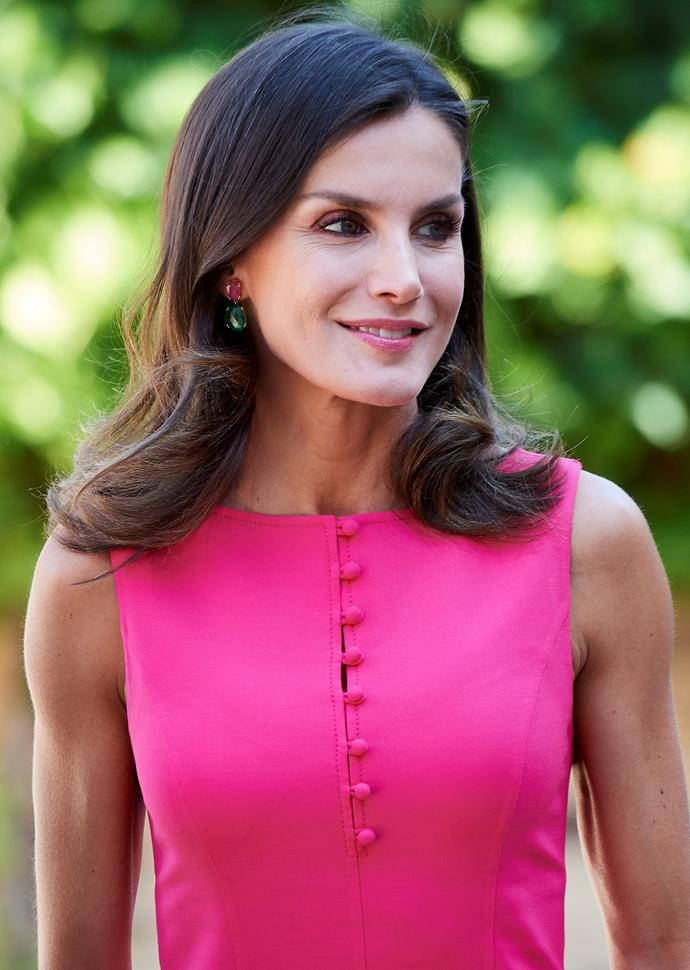 Her matching pink and green earrings are just stunning.