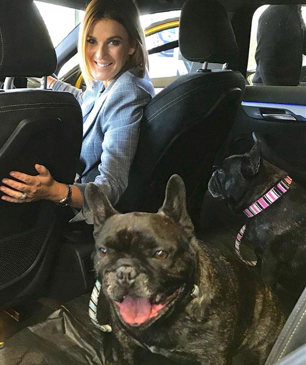 "The TV host shared this snap from ""Bring Your Pets To Work Day"" and aww!"