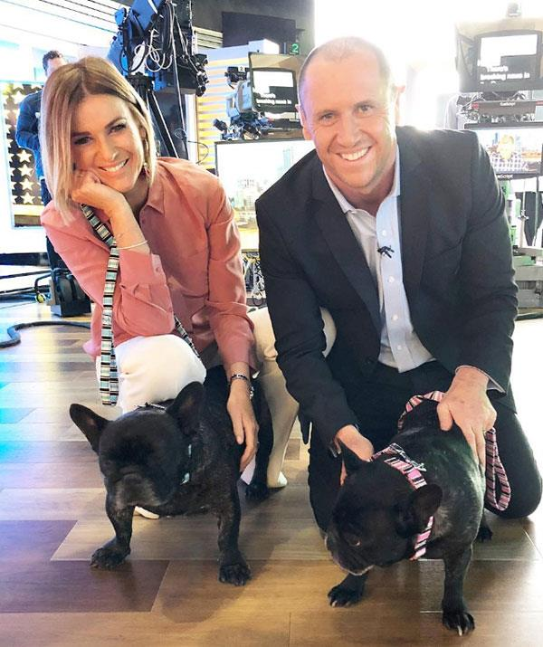 *The Morning Show's* Kylie Gillies  poses alongside co-host Larry Edmur and their pets Pepe and Tilly.