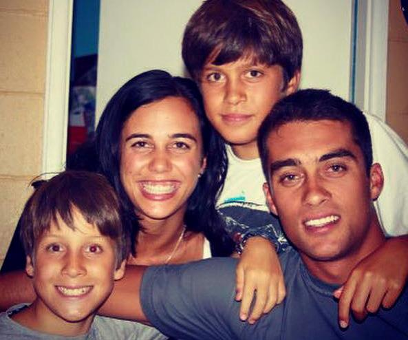 Turia pictured during Christmas 2009 with her brothers.