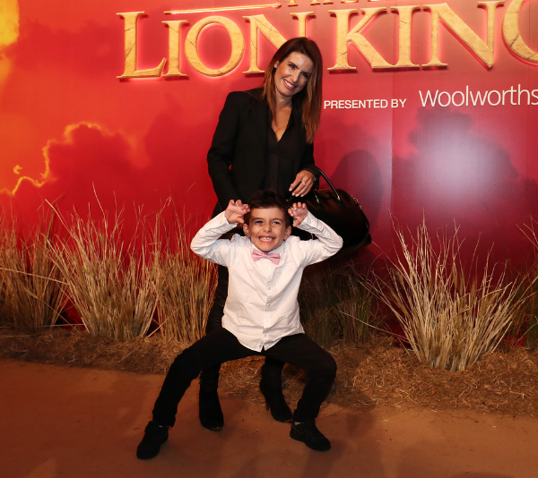 Ada Nicodemou and her son, Johnas, walk the yellow carpet at Sydney's The Lion King premiere.