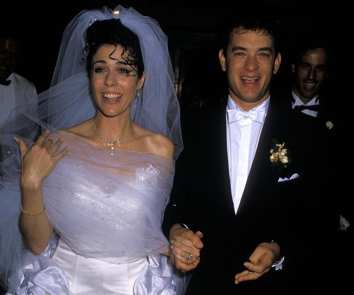 "**Tom Hanks and Rita Wilson** <br><br> [Tom and Rita first met in 1981](https://www.nowtolove.com.au/parenting/celebrity-families/tom-hanks-wife-54040|target=""_blank""), when she starred in an episode of the US sitcom *Bosom Buddies*, in which Tom played the lead role. But Tom was already married to his first wife Samantha Lewes. They tied the knot in 1978 and when Tom was just 21, Samantha gave birth to the couple's son Colin Hanks. In 1982 they had a daughter, Elizabeth Hanks. So when Tom and Rita first crossed paths, forming a romance wasn't really on the agenda. <br><br> Just four years later in 1985, Tom and Rita were reunited on the set of the comedy film *Volunteers*. Despite the fact that he was married at the time, the connection between Tom and Rita was too powerful to deny and finalised his divorce from Samantha in 1987. Just a year later in 1988, Tom and Rita were married and they'e been together ever since."