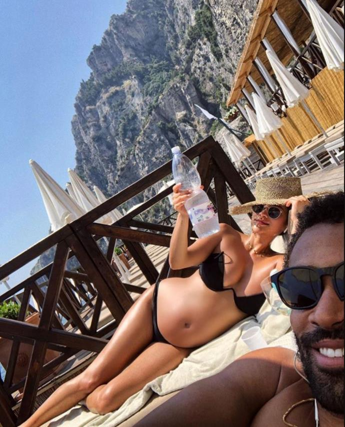 We love this picture of *Pretty Little Lies*' Shay Mitchell and her bump soaking up the sun with boyfriend Matte Babel. The actress is due around October 2019.