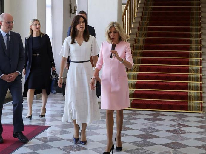 And we fell in love with this white number Mary wore when she met with France's First Lady, Brigitte Macron.