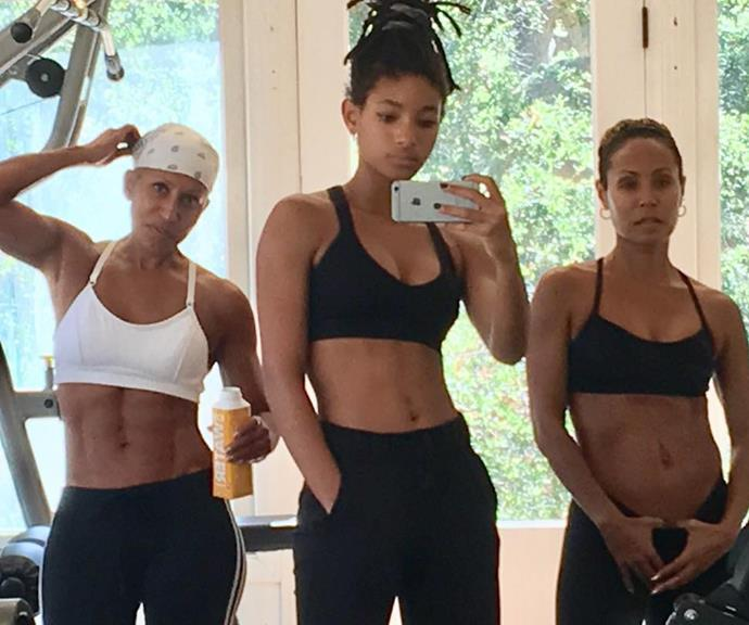 Jada (right) with her daughter Willow (centre) and Jada's mother (left) in the gym.