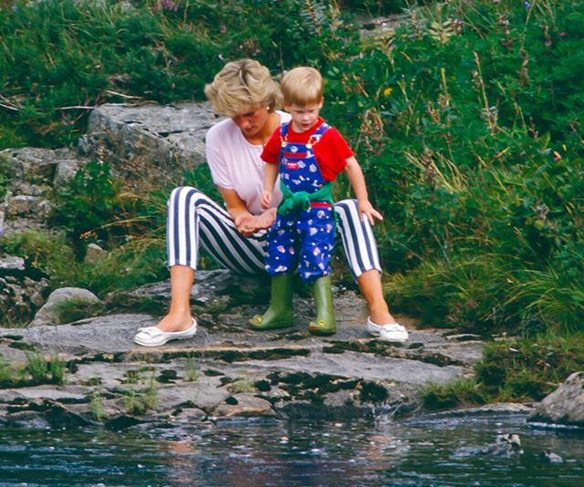 Another traditional royal holiday hot spot is Balmoral. Here, a young Prince Harry is pictured with mum Diana beside the River Dee.