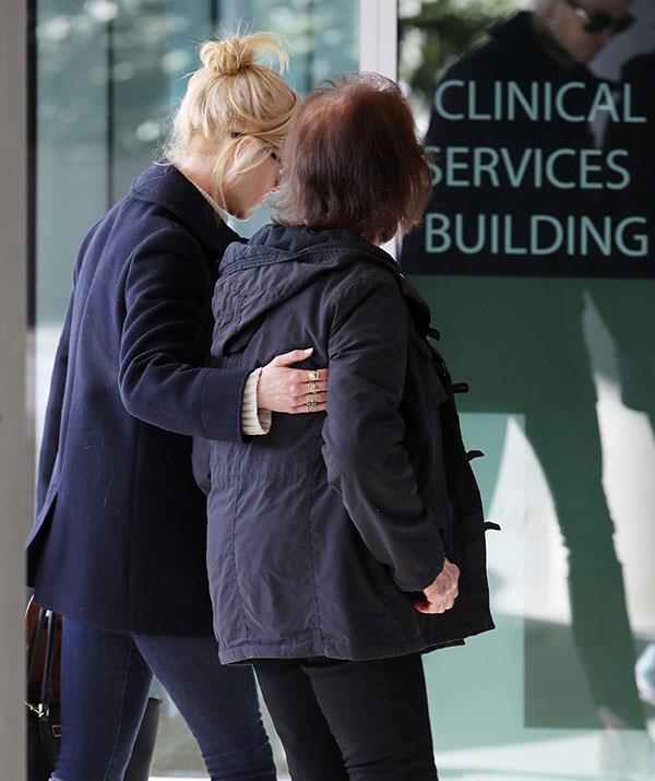 Nicole walks Janelle into the Sydney hospital.
