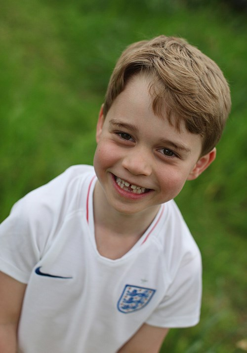 Prince George sported an England football jersey for two of the portraits - much to the approval of the team! *(Image: The Duchess of Cambridge)*