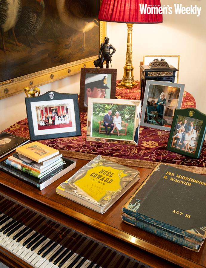 Photos of the family sit on the grand piano.