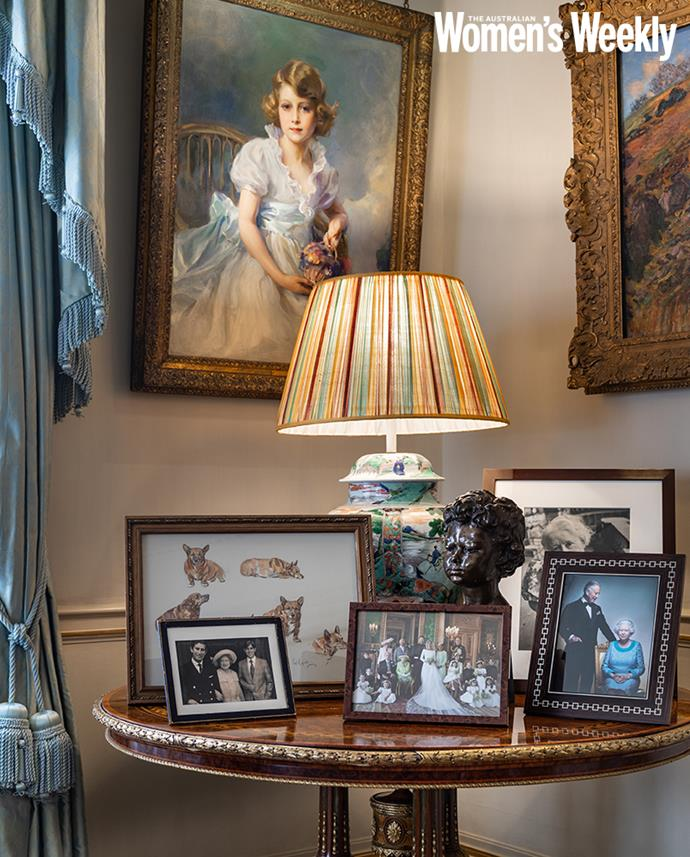 Princess Elizabeth, painted by Philip de László in 1933, hangs above a table of family photos.
