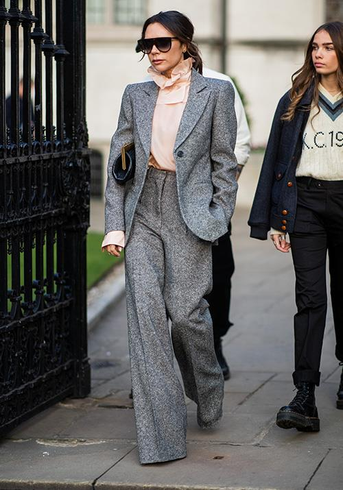 If there was ever a queen of pant suits, Victoria Beckham would be it. We're obsessed with this grey-marl ensemble.