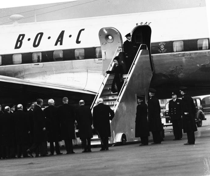 The Queen pictured in 1952 exiting a plane dressed in black, following the death of her father King George IV.