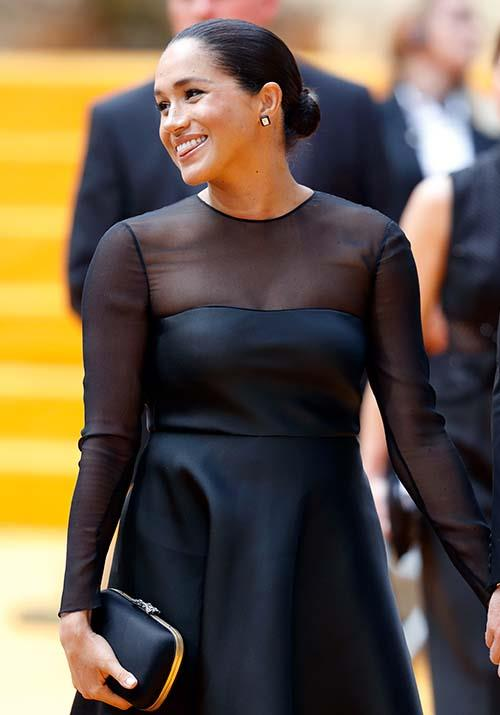 Featuring mesh detailing and a flared waist, the Duchess' red carpet look was all kinds of wonderful. Accessories-wise, Meghan opted for a chic black and gold Gucci clutch and wore black slingback pumps by her go-to brand Aquazzura.