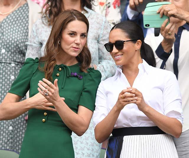 The Duchess looked ultra chic next to sister-in-law Kate Middleton as the pair chatted away between sets. And let's quickly take a moment to revel in Meghan's very cool Le Specs sunglasses!