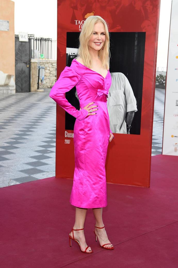 We're obsessed with this stunning pink dress worn by Nicole to the Taormina Film Festival in July.