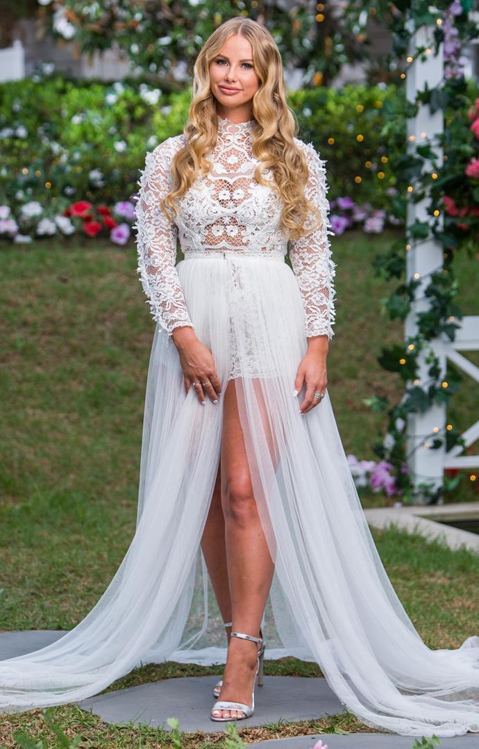 Rachael waltzes in dressed as a bride.