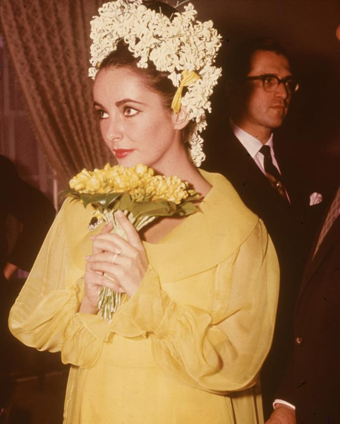 **Elizabeth Taylor** <br><br> At her wedding to actor Richard Burton in 1964, the iconic actress wore a yellow chiffon dress, with a matching bouquet of yellow flowers and a white floral headdress.