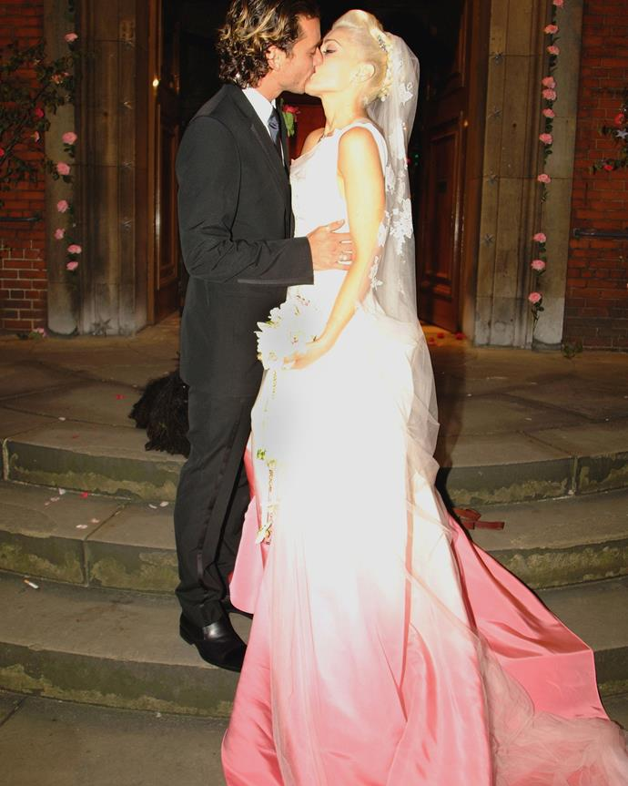 **Gwen Stefani** <br><br> For her wedding, to Bush frontman Gavin Rossdale in 2002, Gwen Stefani chose a gorgeous white and pink ombré gown by John Galliano for Christian Dior, which was custom dip-dyed and hand-painted.