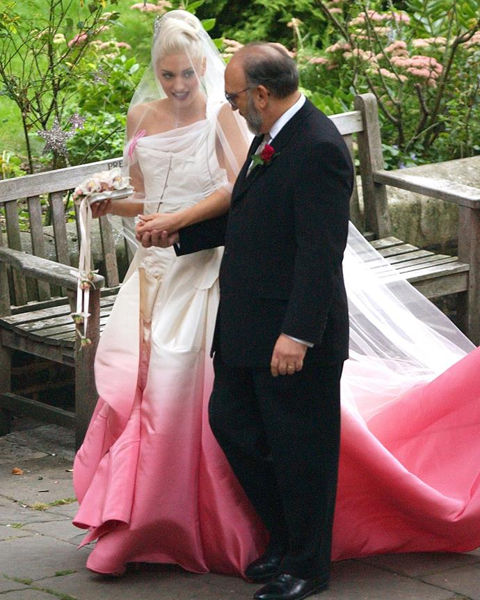 The gorgeous bride arriving at her wedding with her father. Just look at that train!
