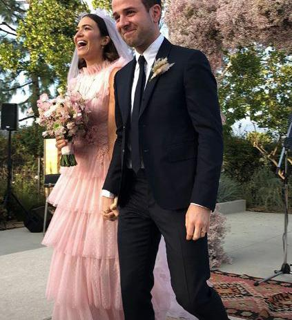 **Mandy Moore** <br><br> During her 2015 nuptials to Dawes frontman Taylor Goldsmith, the *This is Us* actress wore a glorious pink frothy gown and a matching pink veil. Stunning!