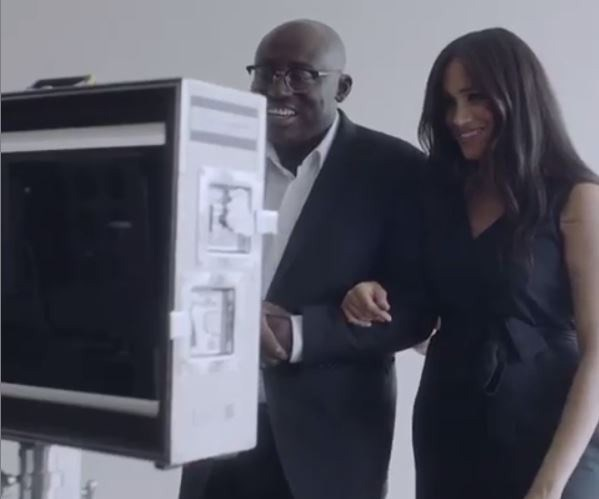 Editor-in-Chief Edward Enninful and Meghan, who was pregnant with Archie at the time, are seen in a behind-the-scenes clip shared to the Sussex Royal Instagram page. *(Image: Instagram/SussexRoyal)*
