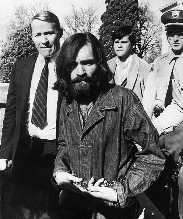 Cult leader Charles Manson in December 1969, leaving a hearing on charges of possessing stolen property. He was later convicted of multiple murders and sentenced to life in prison. He passed away in 2017, aged 83.