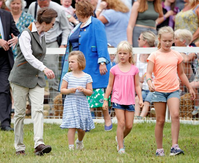 How grown up is little Mia! She's pictured next to Princess Anne from the left. Savannah and Isla Phillips are also pictured.