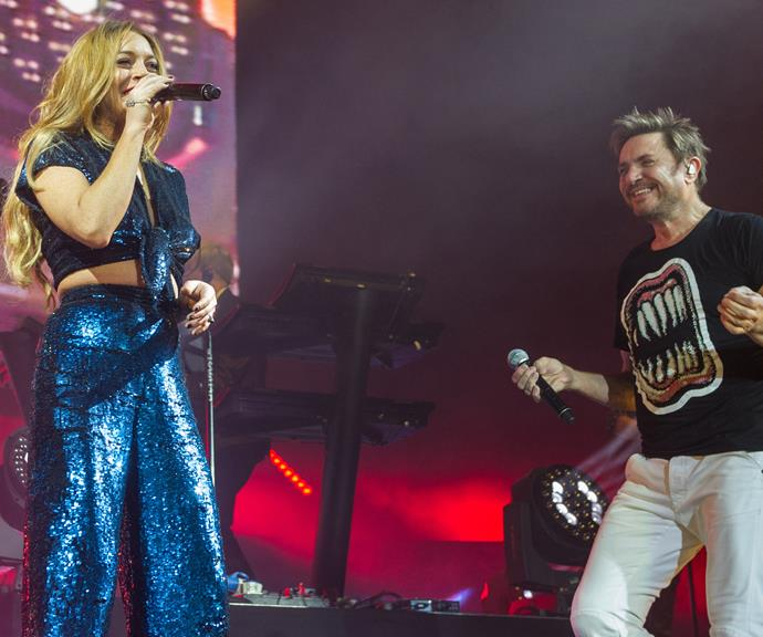 Performing with Simon Le Bon of Duran Duran during a surprise guest performance in London in 2015.