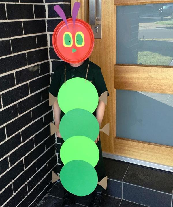 "**The Hungry Little Caterpillar**  Like the caterpillar turned into a beautiful butterfly, you CAN do this! All your need to do is cut-out four green cardboard circles and glue them together. Create some caterpillar feet and glue these on too. Use string to secure the ""caterpillar body"" to your child. Using a red plastic plate, stick on the eyes, mouth and ears with yellow, green and purple paper. Use scissors to carefully mark out eye holes and secure with an elastic. Beautiful!"