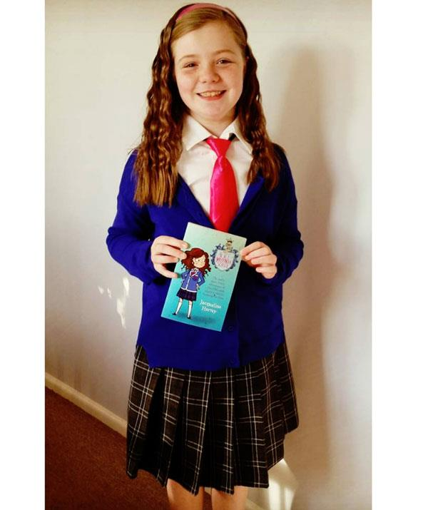 **Alice-Miranda at School**  Well, wouldn't it be handy if your daughter wore a similar school uniform!? This one's a cich to recreate. Pair a tartan or plain black skirt with a blue cardigan. Then add a shirt with a red tie and a headband. And full marks to you.