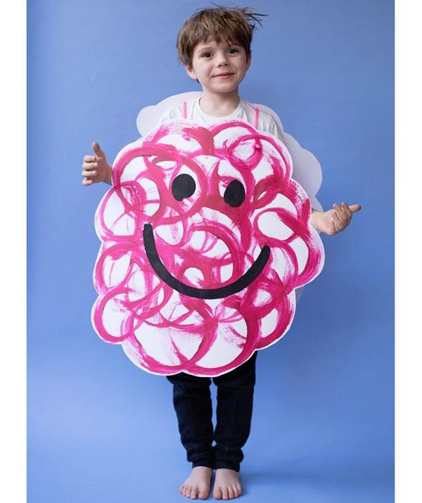"**Mr. Messy**  This one is cool. You'll need a large sheet of white paper. Cut-out two cloud shapes for the front and back of the costume. Use red paint for the ""mess"" and add eyes and a smile with black paint. Secure the cloud shapes together with yarn and Mr. Messy is complete."
