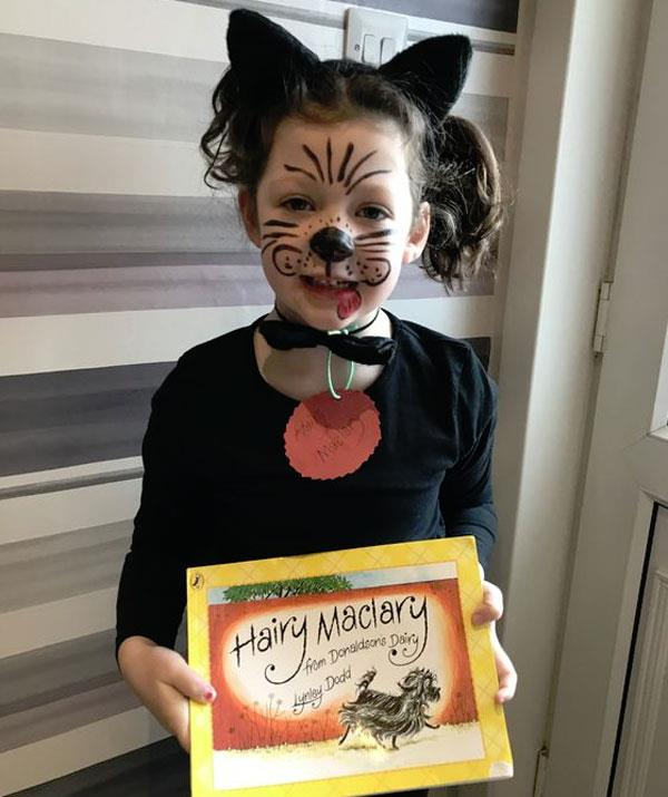 **Hairy Maclary from Donaldson's Dairy**  This outfit is pawfect! Black headband ears, a black bowtie for a collar and a black long-sleeved tee with a red paper, Hairy Maclary name tag. Finish the outfit by showing off your dazzling face-painting skills.