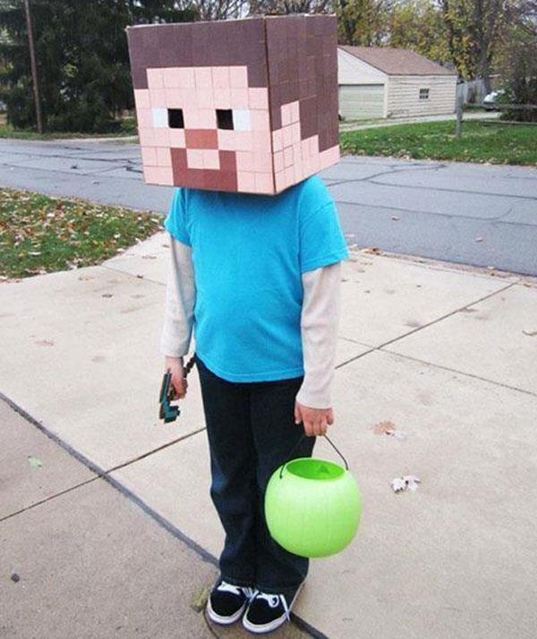**Minecraft**  If your child is *Minecraft* obsessed they are old enough to do the craft work necessary for this Steve costume. A pixelated face can be easily made by painting loads of paper square pieces. Glue them on a box and create peep holes for eyes.