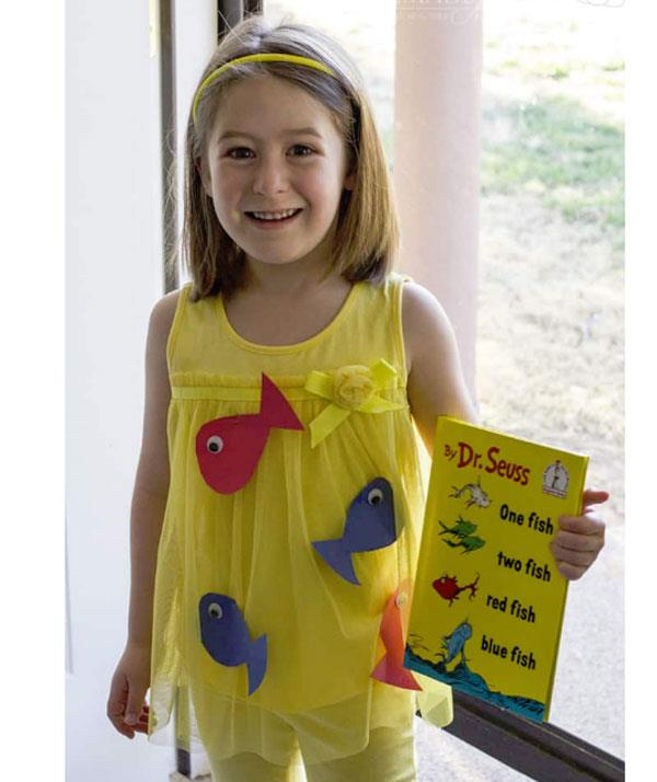 **One Fish Two Fish Red Fish Blue Fish**  Need a quick costume at the last minute? This Dr Seuss themed-look is it! Cut-out cardboard fishes; add eyes and stick them to the front of a yellow shirt. Effective and oh so cute!