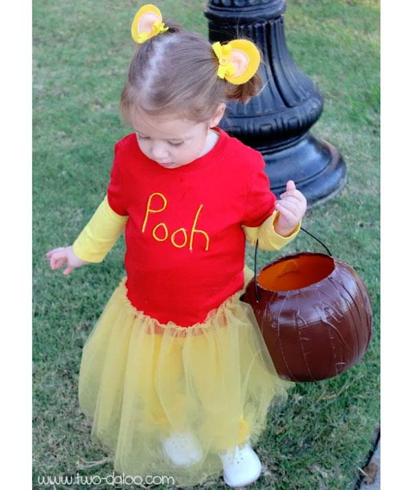 "**Winnie the Pooh**  This is next-level cute. Simply pop a red tee over a long-sleeved yellow t-shirt. Use fabric paint to write, ""Pooh"". Add a yellow tutu and secure pigtails with circular yellow cardboard, for Pooh's ears of course."