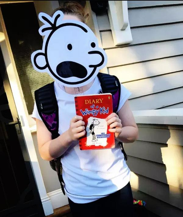 **Diary of a Wimpy Kid**  If your son has a plain white tee and a pair of black shorts all you'll to dress up as main character, Greg Heffley is some white cardboard, a black texta and a pair of scissors. Oh, some arty skills will help you out too.