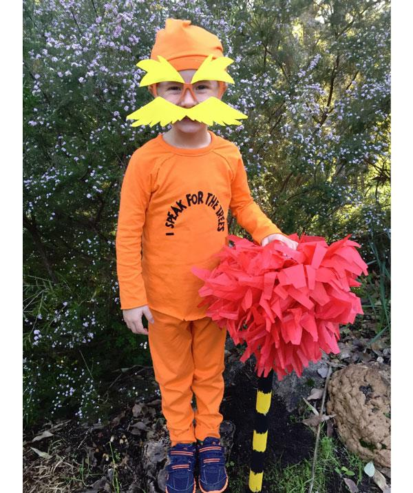 "**The Lorax**  First step is to dress your child in head-to-toe orange. Then, use a black texta to write, ""I Speak For The Trees"" on the tee.  Finally, hit up your local craft store for some plastic orange glasses and yellow cardboard to make the wild eyebrows and moustache."