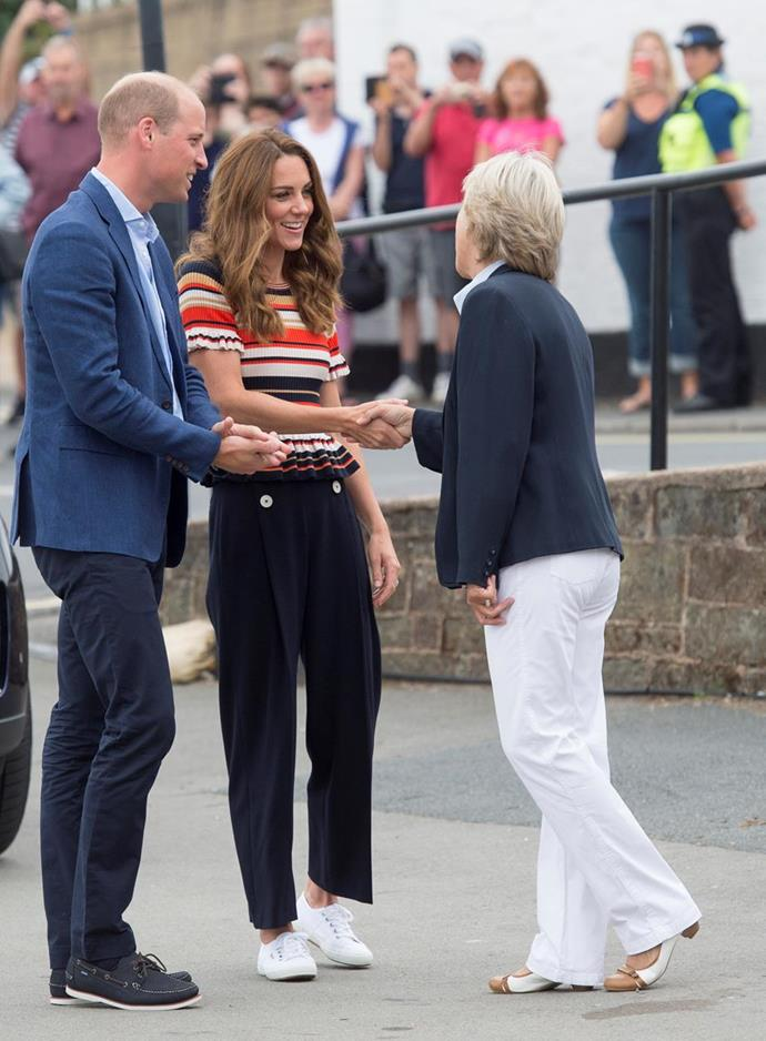 We're obsessed with Kate's first look on race day - her stripey top and wide-legged pants were all kinds of casual chic.