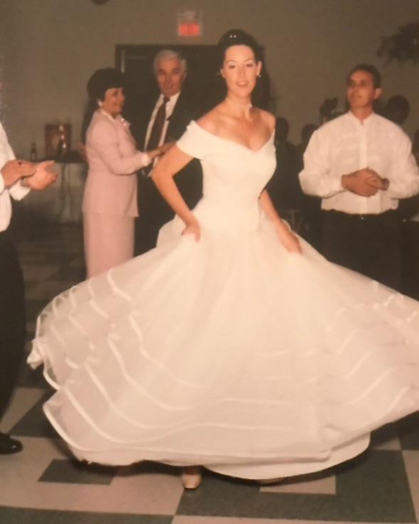 Michelle wearing her princess-style wedding dress at age 24.