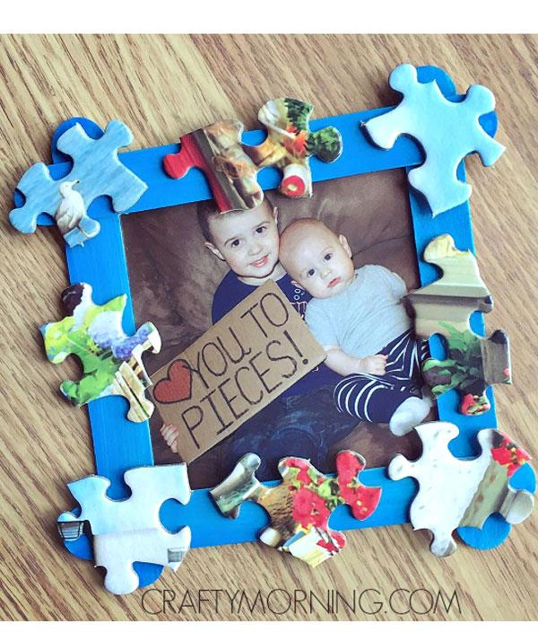 **Love You To Pieces frame**  Now this is a cute gift to piece together!  <br><br> Glue four coloured craft sticks together to make a square frame shape. Glue on some puzzle pieces. Set up a cute photo op with your kids holding a sign with a *Heart* You To Pieces! sign and pop it in the frame.