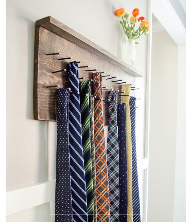 **DIY tie rack**  Older kids will be able to nail this (geddit!?) but younger ones will need help.  <br><br> Hammer the tips of nails into a plank of wood. And voila! Dad now has a useful tie-rack.