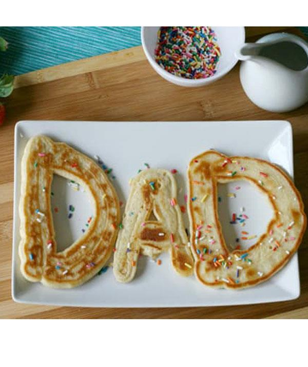 **Dad pancakes**  Making Daddy breakfast in bed? These DAD pancakes covered in sprinkles will hit a sweet spot.