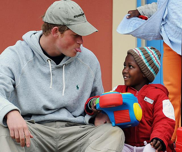 Nothing changed for Prince Harry! The royal has grown up to be cheekier than ever (always well intentioned, mind!). Here, he's seen sharing a sweet moment with a young child while visiting the Lesotho Child Counselling Unit in 2008.
