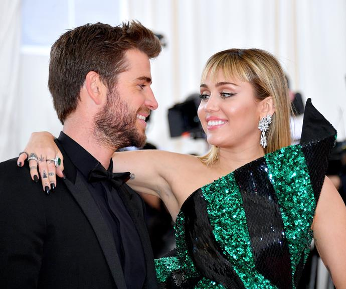 Liam and Miley sharing a sweet moment at the Met Gala in May this year.