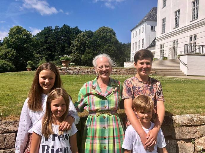 Queen Margrethe poses with her four grandchildren in the Danish sunshine.