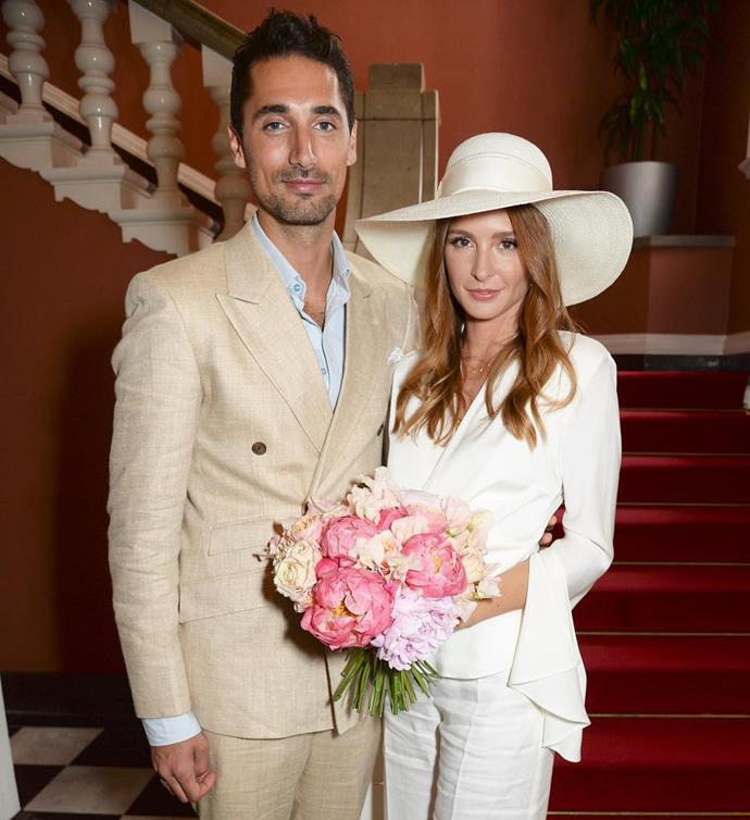 *Made in Chelsea* star Millie Mackintosh looked incredibly chic in this white suit and hat during her casual courthouse wedding.