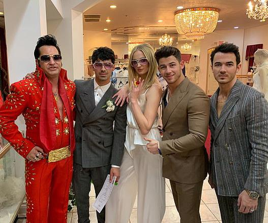 *Game of Thrones* star Sophie Turner got hitched to another Jonas Brother, Joe Jonas (second from left) in a surprise Vegas wedding! <br><br>She wore a very simple and chic white silk jumpsuit for the occasion.