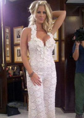 If you're a fan of *The Real Housewives of Atlanta*, you'll be familiar with Kim Zolciak-Biermann, who wore this fun white jumpsuit on her wedding day.