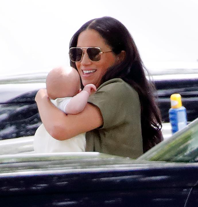 Meghan couldn't have looked more besotted with baby Archie while she cradled him at a polo match in July.