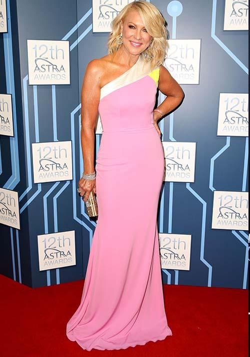 In 2014, the TV maven wowed us once again in bubblegum pink. She looks chic as ever in this one-shoulder creation.